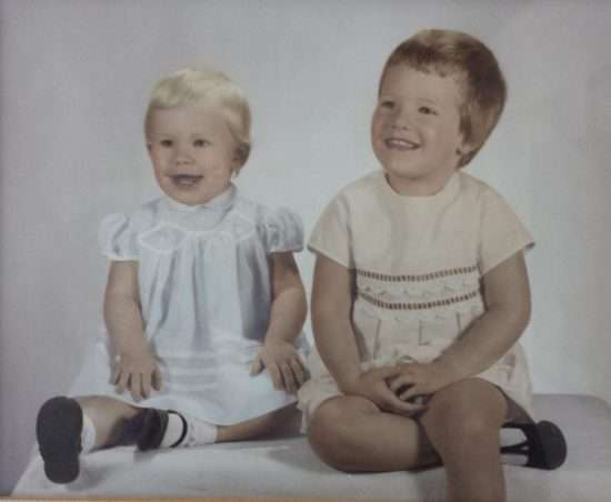 1960s portrait of two little girls in cotton dresses and mary janes