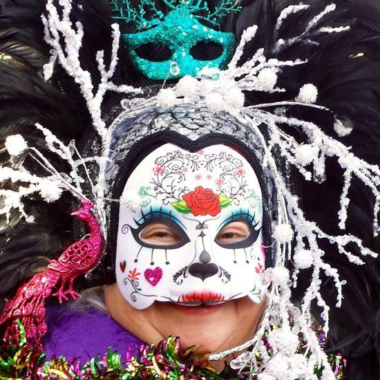 woman in mardi gras mask