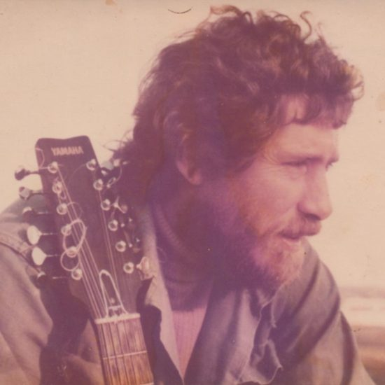 man with beard and 12-string guitar, photo from 1970s