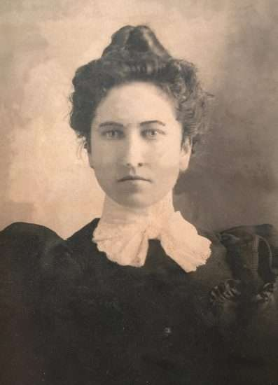 old-fashioned sepia photo of woman with lace color and hair up