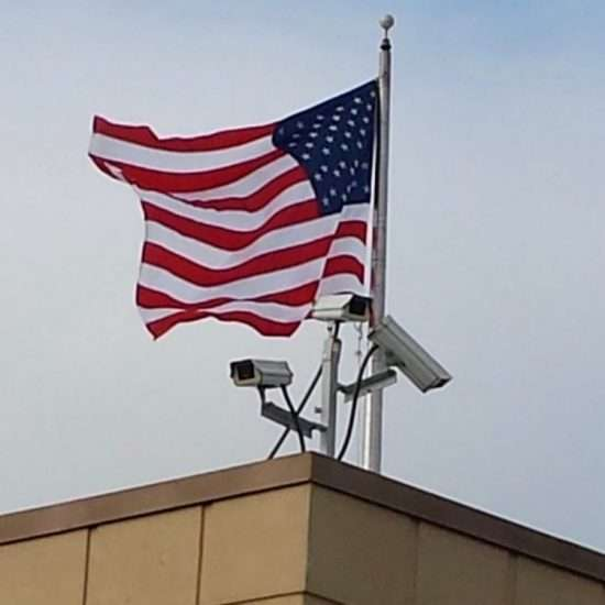 american flag on walmart roof with cameras
