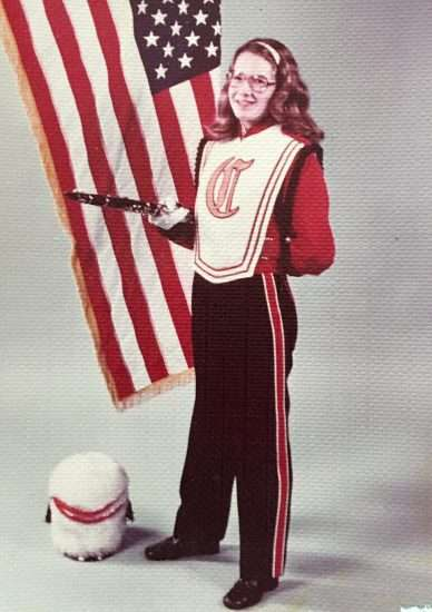 high school clarinet player posing in front of american flag