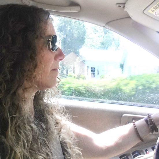 woman wearing aviator Ray Bans driving a Honda Accord