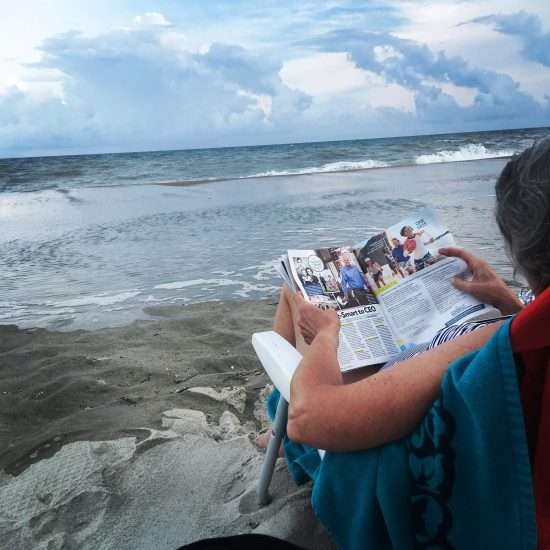 woman reading at the ocean