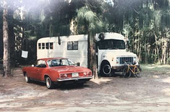 red corvair and white converted school bus
