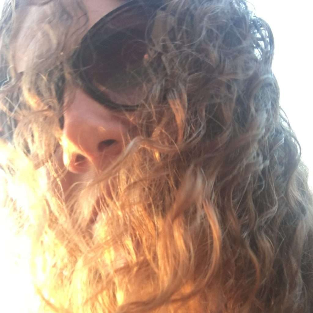 close-up of girl with sunglasses and curly hair