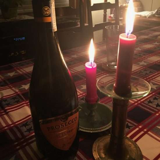 champagne bottle and candles
