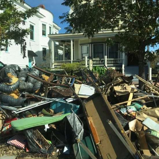 pile of rubbish in front of large historic home after hurricane florence in new bern, nc