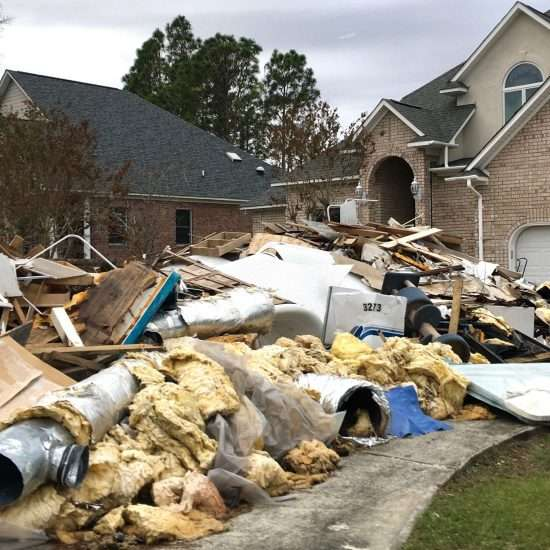 insulation, flooring, and ductwork piled high after hurricane florenc
